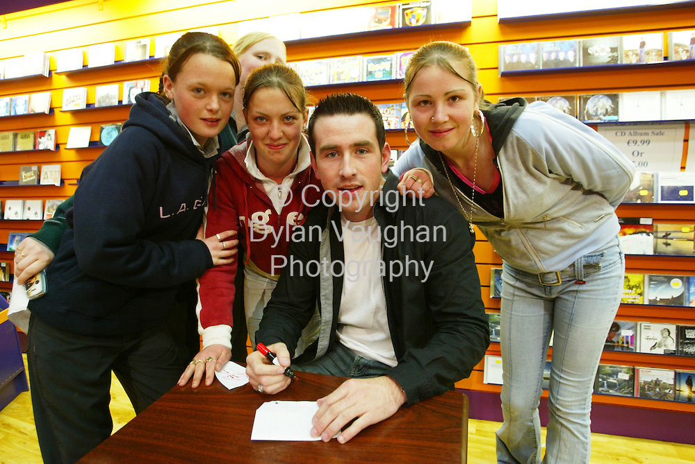 29/4/2004.Chris Doran signs autographs yesterday at Resistance Records in Kilkenny.Pictured with chris are Nooreen Keogh, Tracy Fahey and Melisa Delany..Picture Dylan Vaughan