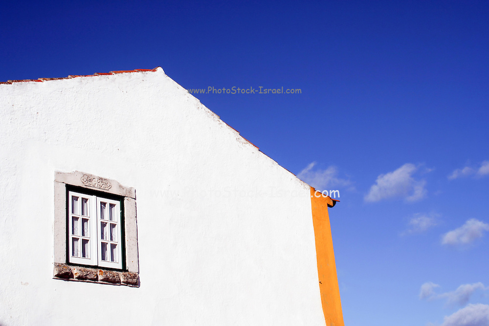 Portugal, Obidos, whitewashed houses with colourful facade