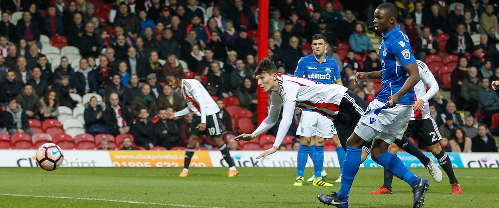 Tom Field of Brentford scores his firs goal for the club and his team's second of the game during the FA Cup 3rd round match between  Brentford and Eastleigh FC  at Griffin Park, London<br /> Picture by Mark D Fuller/Focus Images Ltd +44 7774 216216<br /> 07/01/2017