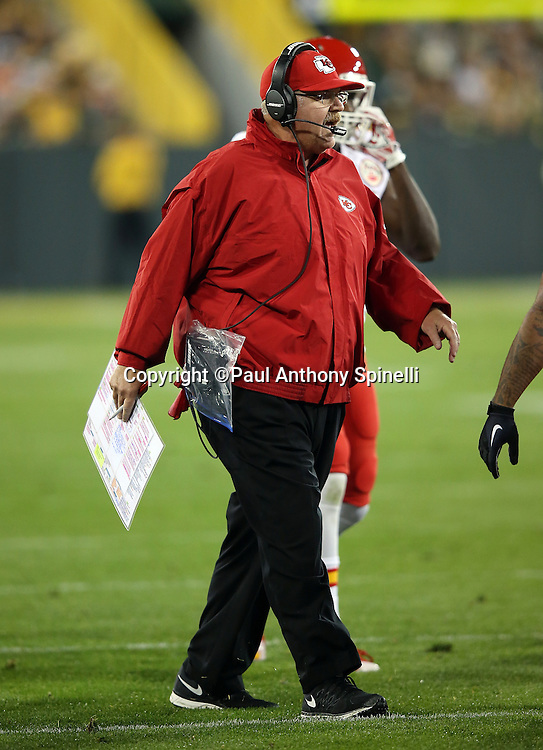Kansas City Chiefs head coach Andy Reid yells out toward the field as he holds his play chart near the sideline during the 2015 NFL week 3 regular season football game against the Green Bay Packers on Monday, Sept. 28, 2015 in Green Bay, Wis. The Packers won the game 38-28. (©Paul Anthony Spinelli)