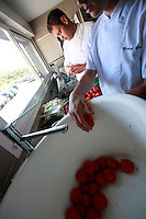 Restaurant Bras, Laguiole, in the Aubrac region, France..Preparation and eating of the staff meal - tomato salad