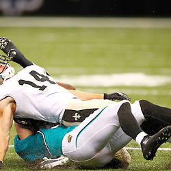 August 17, 2012; New Orleans, LA, USA; New Orleans Saints wide receiver Andy Tanner (14) is injured as he is hit by Jacksonville Jaguars linebacker Paul Posluszny (51) during the first half of a preseason game at the Mercedes-Benz Superdome. Mandatory Credit: Derick E. Hingle-US PRESSWIRE