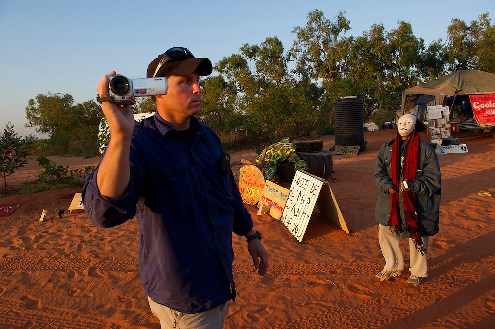 A gas worker films blockade as protesters block traffic in front of their camp on the road leading to the planned LNG gas hub at  James Price Point, near Broome, Kimberley, Western Australia. Photograph by David Dare Parker °SOUTH