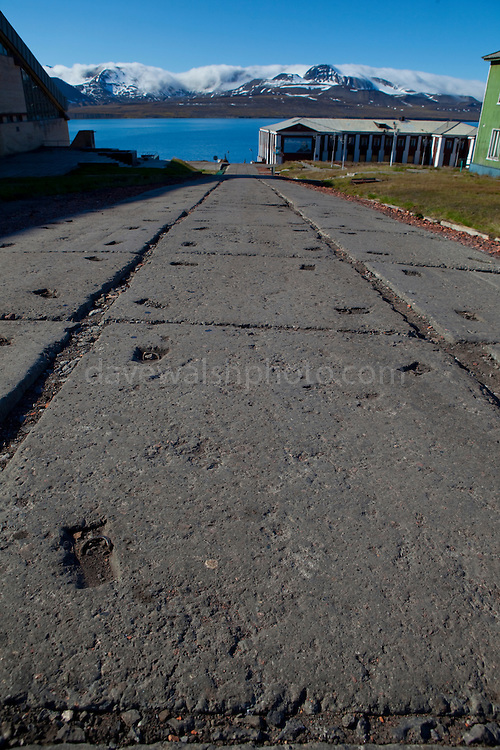The main street of Barentsburg, a Russian coal mining town in the Norwegian Archipelego of Svalbard. Once home to about 2000 miners and their families, less than 500 people now live here.