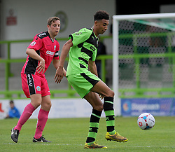 Dover Athletic's Connor Essam loses the ball to Forest Green Rovers's Kurtis Guthrie.  - Photo mandatory by-line: Nizaam Jones - Mobile: 07966 386802 - 25/04/2015 - SPORT - Football - Nailsworth - The New Lawn - Forest Green Rovers v Dover - Vanarama Conference League