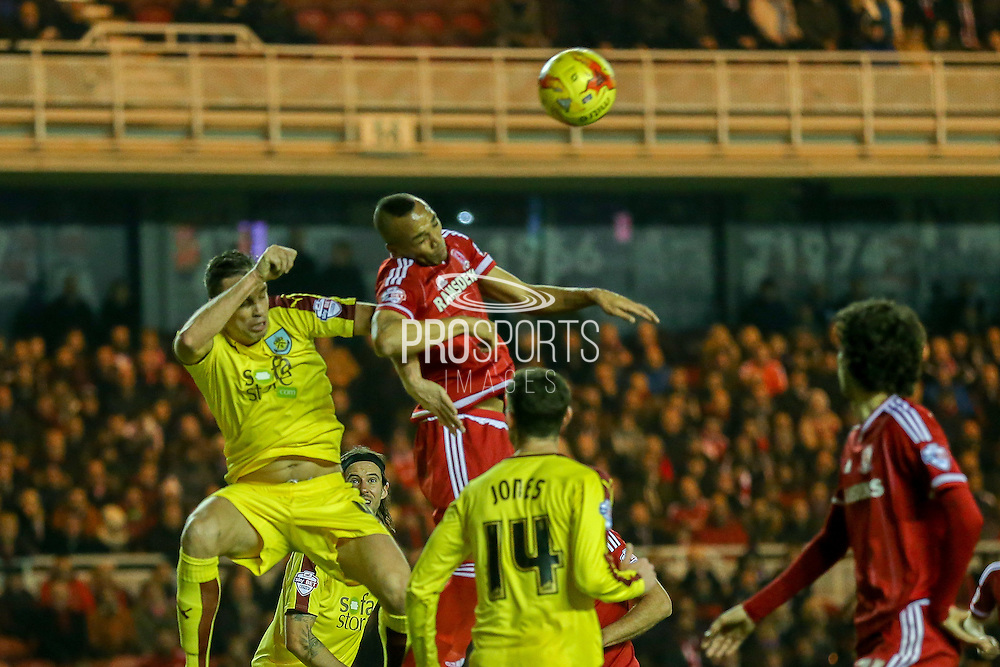 Burnley defender Michael Duff  and Middlesbrough midfielder Emilio Nsue  challenge in the air during the Sky Bet Championship match between Middlesbrough and Burnley at the Riverside Stadium, Middlesbrough, England on 15 December 2015. Photo by Simon Davies.
