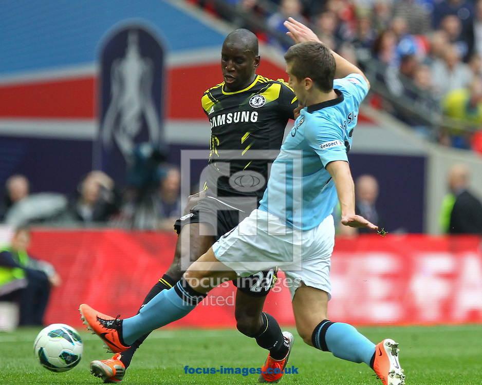 Picture by John Rainford/Focus Images Ltd +44 7506 538356.14/04/2013.Demba Ba of Chelsea and Matija Nastasic of Manchester City during the FA Cup semi final match at Wembley Stadium, London.