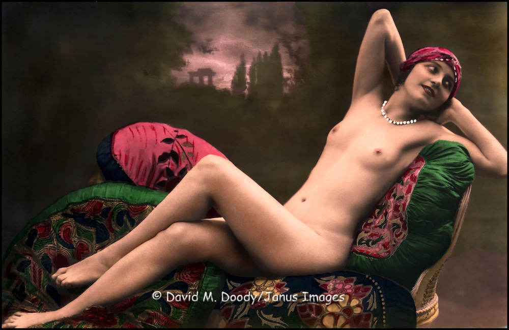 Tinted nude woman, circa 1920. French Realphoto postcard.