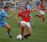 Ohio State forward Lauren Granberg (18) pokes the ball away from University of North Carolina forward Elizabeth Burchenal (23) as OSU takes on UNC in the first half of an NCAA women's college soccer game in Columbus, Ohio on Sunday, Sept. 4, 2011, at Jesse Owens Memorial Stadium.