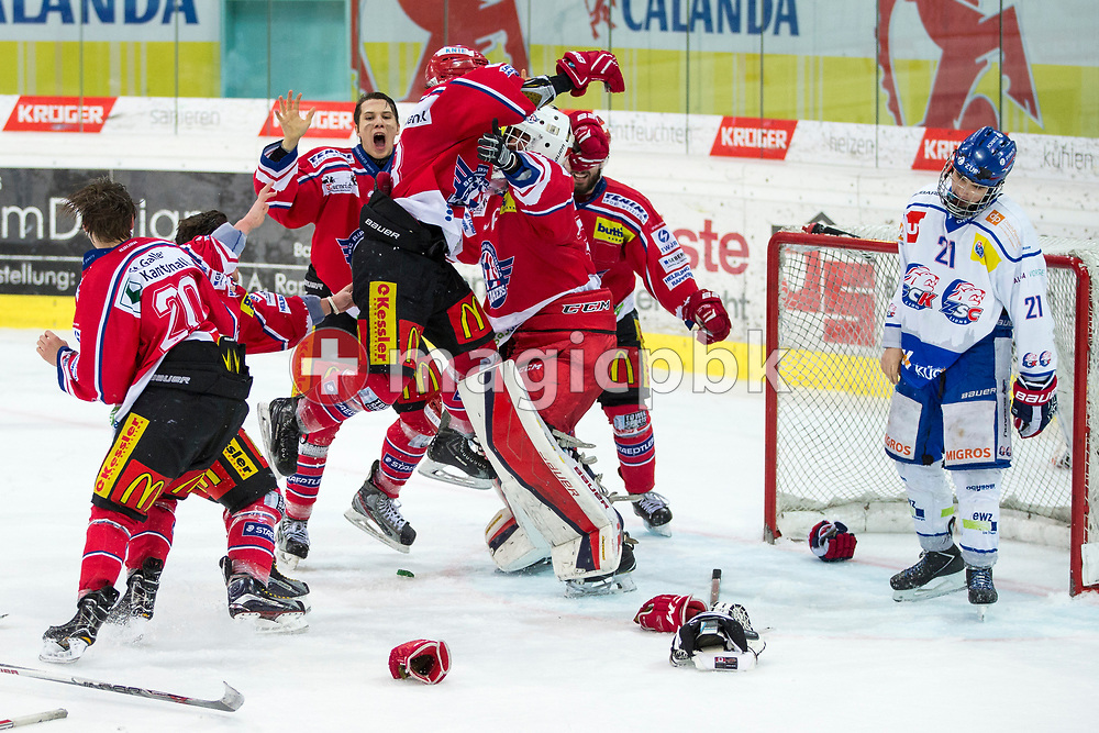 (L-R) Rapperswil-Jona Lakers players Cedric Sieber, Janis Egger, Lars Mathis, Siro Rutzer, goaltender Beat Trudel and Elia Auriemma celebrate their Swiss Champion title, while ZSC Lions defenseman Dominique Posch is disappointed after the fifth Elite B Playoff Final ice hockey game between Rapperswil-Jona Lakers and ZSC Lions held at the SGKB Arena in Rapperswil, Switzerland, Sunday, Mar. 19, 2017. (Photo by Patrick B. Kraemer / MAGICPBK)