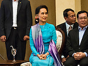 23 JUNE 2016 - MAHACHAI, SAMUT SAKHON, THAILAND:  AUNG SAN SUU KYI waits to speak during a visit to the Burmese community in Samut Sakhon, a province south of Bangkok. Tens of thousands of Burmese migrant workers, most employed in the Thai fishing industry, live in Samut Sakhon. Aung San Suu Kyi, the Foreign Minister and State Counsellor for the government of Myanmar (a role similar to that of Prime Minister or a head of government), is on a state visit to Thailand. Even though she and her party won the 2015 elections by a landslide, she is constitutionally prohibited from becoming the President due to a clause in the constitution as her late husband and children are foreign citizens       PHOTO BY JACK KURTZ
