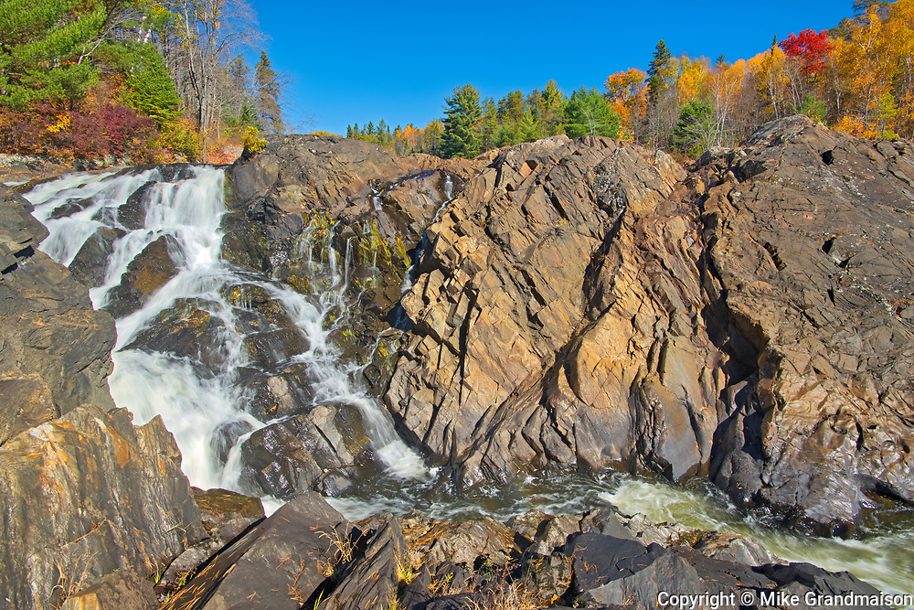 The Aux Sables River flows over the Precambrian Shield rock over a waterfall<br />