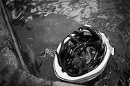 Picture by Andrew Tobin/Tobinators Ltd +44 7710 761829<br /> 04/08/2013<br /> A rider's helmet floats in a water trough during the Cycle Messenger World Championships held in Lausanne, Switzerland. Started in 1993 by Achim Beier from Berlin, the championships are not only a sporting contest but an opportunity to unite friends and bicycle enthusiasts worldwide. The event comprises a number of challenges including a sprint, a track stand (longest time stationary on the bike), a cargo race where heavy loads are carried on special bikes, and the main race. The course winds through central Lausanne and includes bridges, stairs, cobbles, narrow alleyways and challenging hills. The main race simulates the job of a bike courier making numerous drops and pickups across the city. Riders need to check in at specific checkpoints, hand over their delivery and get a new one. The main race can take up to 4 hours for each competitor to complete.