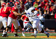 Ashton Thomas (73) of the Abilene Christian Wildcats tries to get around the Pittsburg State Gorillas offensive line during Saturday's football game at Carnie Smith Stadium on October 5, 2013 in Pittsburg, Kansas. (David Welker)