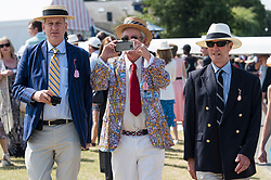 © Licensed to London News Pictures. 04/07/2018. Henley-on-Thames, UK. A group of elderly men in rowing club colours attend day one of the Henley Royal Regatta, set on the River Thames by the town of Henley-on-Thames in England. Established in 1839, the five day international rowing event, raced over a course of 2,112 meters (1 mile 550 yards), is considered an important part of the English social season. Photo credit: Ben Cawthra/LNP