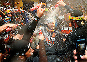 San Francisco Giants starting pitcher Tim Hudson is drenched in champagne and beer after his team clinched the National League Championship in 2014.