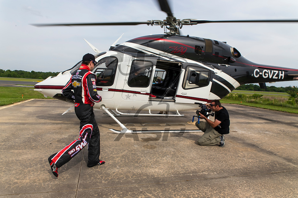 Concord, NC - May 25, 2014:  NASCAR driver, Kurt Busch, boards his Bell Helicopter 429 at Concord Regional Airport to fly to Charlotte Motor Speedway to run the Coca-Cola 600 NASCAR Sprint Cup race at Concord, NC.<br /> <br /> MANDATORY PHOTO CREDIT:  Walter G. Arce, Sr. KBI/ActionSportsInc.com