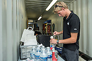 Emirates Team New Zealand sailor Edwin De Laat prepares electrolite drinks before racing on day four of the Extreme Sailing Series Regatta at Nice. 5/10/2014