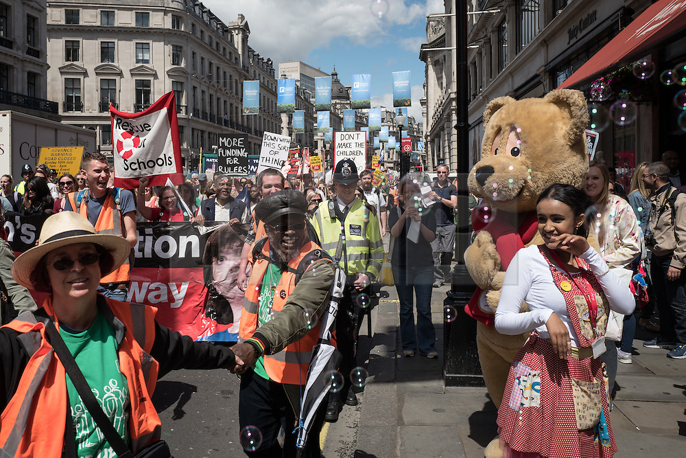 © Licensed to London News Pictures. 05/07/2016. London, UK. Entertainers from famous toy shop Hamlets greet thousands of school teachers, parents and pupils as they march through central London as teachers go on strike. The strike, called by the National Union of Teachers (NUT), is in response to cuts to funding and issues with workload, pay and other conditions. Photo credit: Rob Pinney/LNP