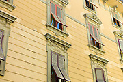Traditional architecture and window shutters Via Cesare Battisti in Lucca, Italy