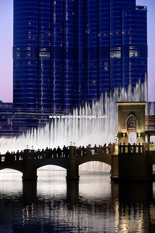 The Dubai Fountain in Downtown Dubai, with Burj Khalifa in the background and the bridge from The Dubai Mall to Souk Al Bahar in the foreground