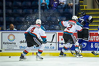 KELOWNA, CANADA - AUGUST 31:  Tanner Sidaway #22 of the Victoria Royals is checked into the boards by Jackson Desouza #2 as Devin Steffler #4 of the Kelowna Rockets goes for the puck during first period on August 31, 2018 at Prospera Place in Kelowna, British Columbia, Canada.  (Photo by Marissa Baecker/Shoot the Breeze)  *** Local Caption ***