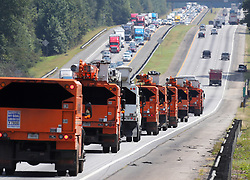 Traffic on I-75 North fleeing Hurricane Irma backs up moving at a crawl toward Atlanta while power trucks head south toward the Georgia coast in preparation for the storm on Friday, September 8, 2017, in Griffin.  (Curtis Compton/Atlanta Journal-Constitution/TNS/Sipa USA)