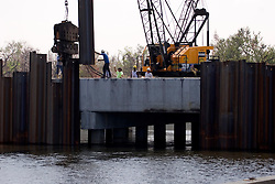 21 Sept 2005. New Orleans, Louisiana.  Hurricane Katrina/Rita aftermath. <br /> Army Corps of engineers race against time to shore up weak levee defences at the 17th street canal in New Orleans in preparation for Hurricane Rita storm surge that could once again swamp the city. The Corps dammed the canal with steel plates to prevent water entering the city.<br /> Photo; ©Charlie Varley/varleypix.com
