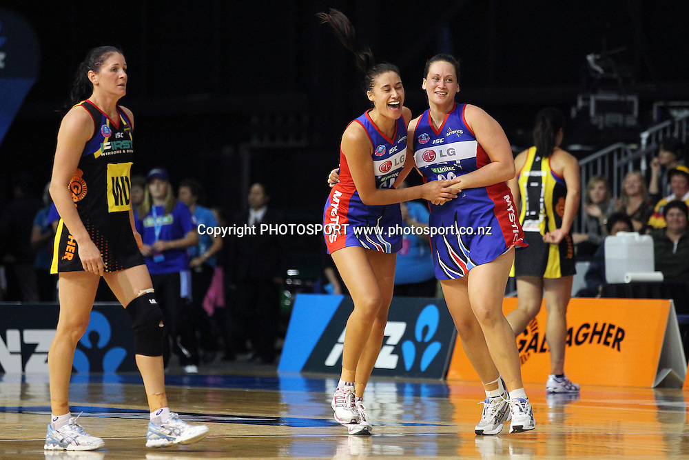 Mystics' Maria Tutaia and Cathrine Latu celebrate the win as Magic's Peta Scholz looks on. ANZ Netball Championship, Preliminary Final, Waikato/BOP Magic v LG Northern Mystics. Mystery Creek Events Centre, Hamilton, New Zealand. Sunday 15th May 2011. Photo: Anthony Au-Yeung / photosport.co.nz