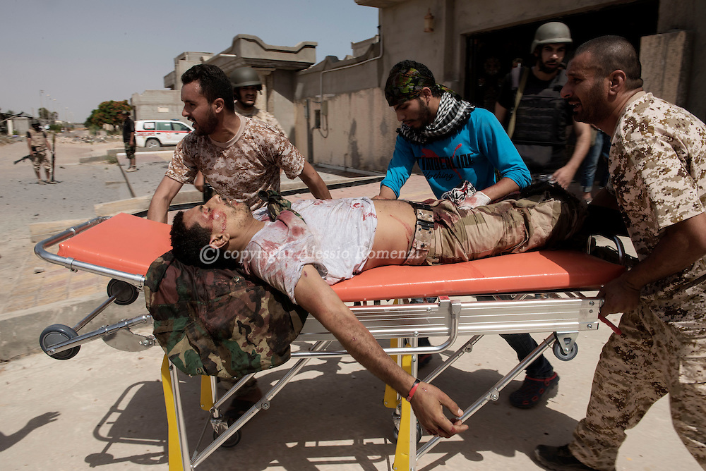 Libya: injured fighter affiliated with Libya's Government of National Accord's (GNA) in 700 neighbourhood on the frontline with ISIS. Alessio Romenzi