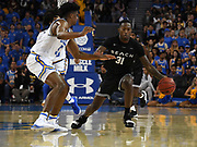 Nov 6, 2019; Los Angeles, CA, USA; Long Beach State 49ers guard Chance Hunter (31) is defended by UCLA Bruins guard Chris Smith (5) in the first half at Pauley Pavilion.
