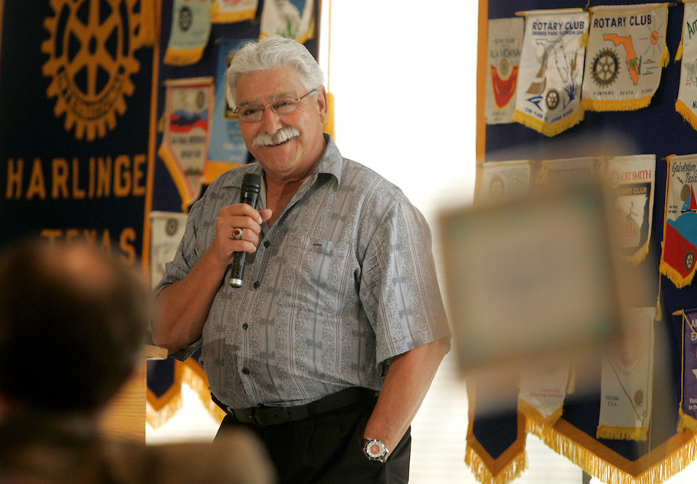 "Photo by Alex Jones..Al Garza, leader of the Minuteman Project, addresses a crowd gathered at a meeting of the Rotary Club at the Harlingen Country Club on Friday afternoon.  Garza, who spoke at length about the project's history and its plans to start patrolling the Rio Grande Valley, said that he is not anti-immigration.  ""There's a main door that you enter through -- just stop and sign the guestbook.  That's all we ask."""