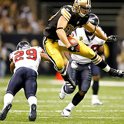 September 25, 2011; New Orleans, LA, USA; New Orleans Saints tight end Jimmy Graham (80) leaps over Houston Texans cornerback Glover Quin (29)  during the third quarter at the Louisiana Superdome. The Saints defeated the Texans 40-33. Mandatory Credit: Derick E. Hingle