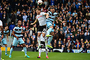 Queens Park Rangers forward Conor Washington (9) challenges Fulham FC forward Chris Martin (25) in the air during the EFL Sky Bet Championship match between Fulham and Queens Park Rangers at Craven Cottage, London, England on 1 October 2016. Photo by Jon Bromley.