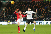 Nottingham Forest forward Joe Lolley (23) clears from Derby County defender Scott Malone (46) during the EFL Sky Bet Championship match between Derby County and Nottingham Forest at the Pride Park, Derby, England on 17 December 2018.