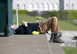© under license to London News Pictures.  15/03/2011 A man enjoys the Spring sunshine and warm weather in Plymouth, Devon. Picture credit sould read: David Hedges/LNP