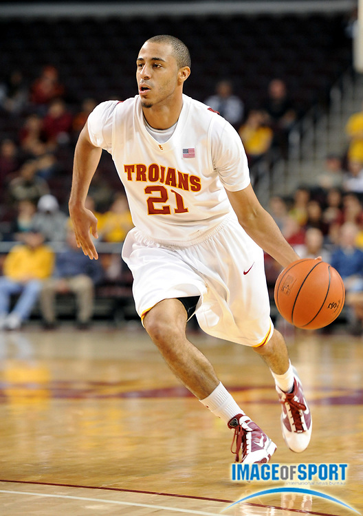 Jan 2, 2010, Los Angeles, CA, USA; Southern California Trojans guard Dwight Lewis (21) dribbles the ball during the game against the Arizona State Sun Devils at the Galen Center. USC defeated Arizona State 47-37.