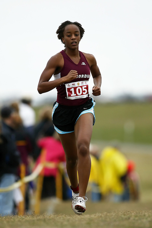 (Kingston, Ontario -- 14 Nov 2009)  SHERISSE MCLAUGHLIN of the Concordia University runs to 126 place at the  2009 Canadian Interuniversity Sport CIS Cross Country Championships at Forth Henry Hill in Kingston Ontario. Photograph copyright Sean Burges / Mundo Sport Images, 2009.