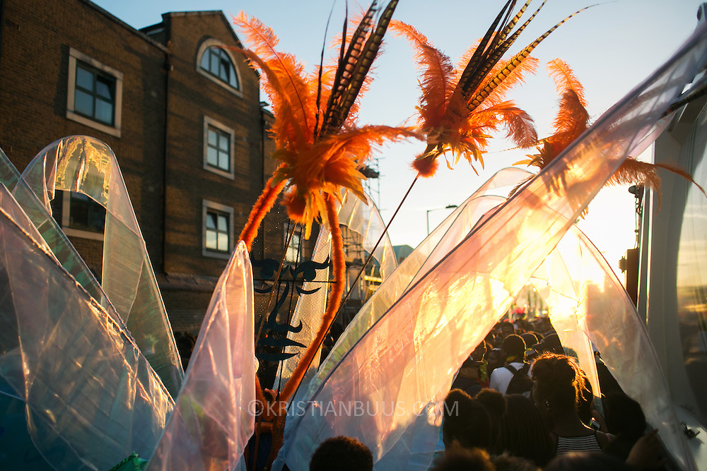 The setting sun in Ridley Road. Hackney carnival 2016 took place on a hot Indian summer's day, September 2016 with the streets full of partying people.