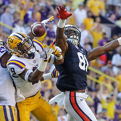 Oct 14, 2017; Baton Rouge, LA, USA; LSU Tigers cornerback Andraez Williams (29) and safety Grant Delpit (9) break up a pass to Auburn Tigers wide receiver Darius Slayton (81) during the second half of a game at Tiger Stadium. LSU defeated Auburn 27-23. Mandatory Credit: Derick E. Hingle-USA TODAY Sports