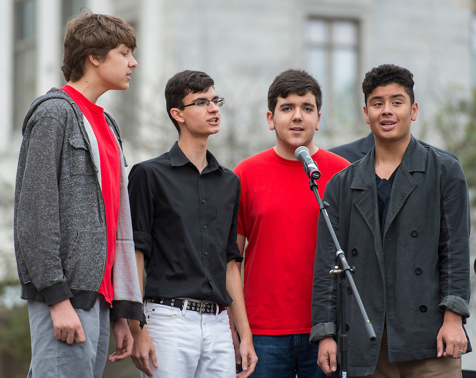 Vocal department students sing the national anthem during a groundbreaking ceremony for the new High School for Performing and Visual Arts in downtown Houston, December 14, 2014.