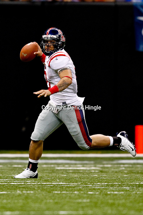 Sep 11, 2010; New Orleans, LA, USA; Mississippi Rebels quarterback Jeremiah Masoli (8)looks to pass against the Tulane Green Wave during a game at the Louisiana Superdome. The Mississippi Rebels defeated the Tulane Green Wave 27-13.  Mandatory Credit: Derick E. Hingle