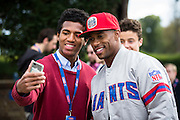 Wide receiver Victor Cruz of the New York Giants poses for a selfie with a fan during the New York Giants Press Day  at Syon House, Brentford, United Kingdom on 21 October 2016. Photo by Jason Brown.