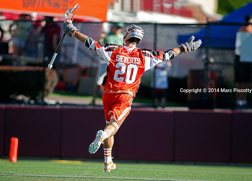 SHOT 8/16/14 5:43:34 PM - The Denver Outlaws Jeremy Sieverts #20 celebrates after scoring the game winning goal against the New York Lizards in the closing minutes during their MLL Semifinals matchup at Peter Barton Lacrosse Stadium on the University of Denver campus in Denver, Co. Saturday. The Denver Outlaws won the game 14-13 to advance. (Photo by Marc Piscotty / © 2014)