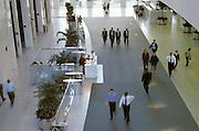 businessmen in office building lobby