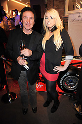 KENNEY JONES and his daughter CASEY JONES at a party to celebrate the launch of Armin Storm's One Week Watch at Asprey, 167 New Bond Street, London W1 on 18th November 2010.