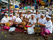 "02 AUGUST 2017 - UBUD, BALI, INDONESIA: A gamelan orchestra performs during the ""Merchants' Day"" ceremony at the Pura (Temple) Melanting Pasar Ubud, the small Hindu temple in the Ubud market. It's a day that merchants throughout Ubud come to the temple to make offerings and pray for prosperity.    PHOTO BY JACK KURTZ"