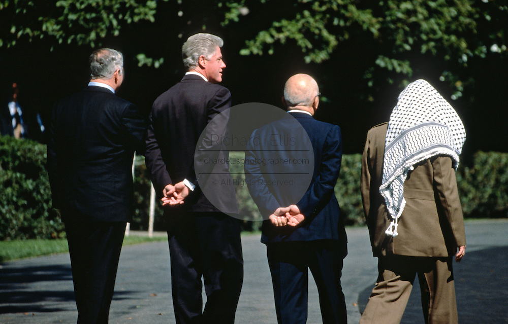 US President Bill Clinton walks with mid-east leaders on the South Lawn of the White House October 1, 1996 during the Middle East Peace Summit in Washington, DC.  The group is (R-L) Palestinian Leader Yasser Arafat, King Hussein of Jordan, President Bill Clinton and Israel Prime Minister Benjamin Netanyahu.