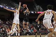Long Beach State 49ers guard Ron Freeman (1) is defended by Southern California Trojans forward Nick Rakocevic (31) during an NCAA basketball game in Los Angeles, Nov 28, 2018. USC defeated Long Beach State 75-65.