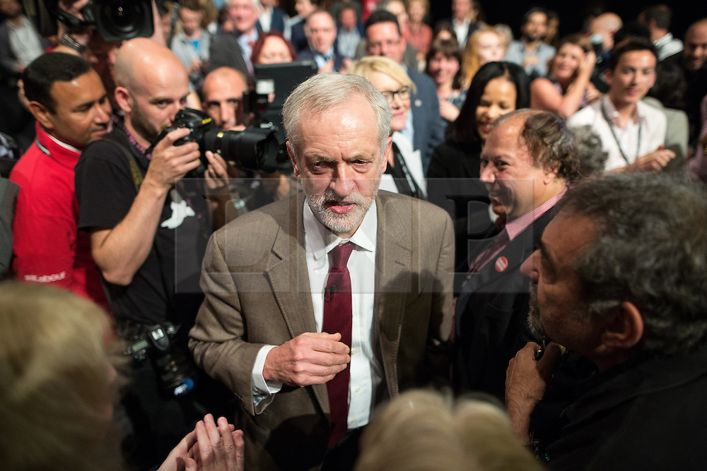 © Licensed to London News Pictures . 29/09/2015 . Brighton , UK . JEREMY CORBYN surrounded by media and crowd after delivering his speech to the 2015 Labour Party Conference . Photo credit : Joel Goodman/LNP